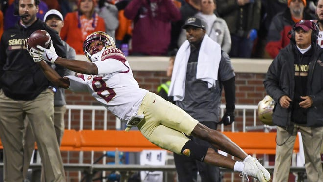 Florida State wide receiver Nyqwan Murray (8) attempts to make a catch against Clemson at Clemson Memorial Stadium.