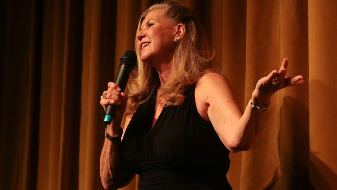 Carla Dilley speaks as the opening storyteller at the Coachella Valley Storytellers Project at Camelot Theaters, November 13, 2017.