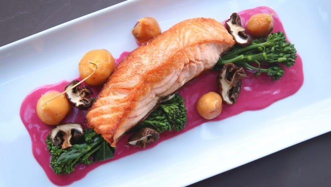 The baked steelhead fish at Liberty Station comes with mushrooms and berry butter. The baked steelhead fish comes with mushrooms and berry butter.