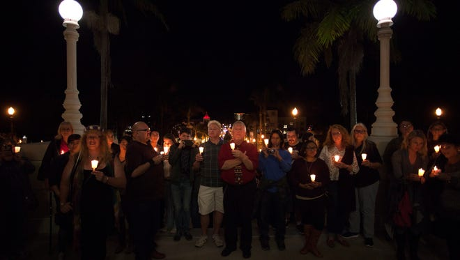 A candlelight vigil takes place on the steps of Ventura City Hall during the city's first Transgender Day of Remembrance in 2015.