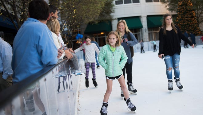 Carolien Bannister, 9, leads a group of skaters on the ice during the official opening of the United Community Bank Ice on Main ice skating rink on Friday, Nov. 16, 2017.