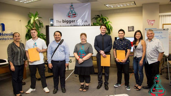 The University of GuamEntrepreneur Society's held a Startup Weekend event. From left: Jessica Atalig, judge; JP Eltringham, first place; Chris Wong, participant; Desiree Quinata, participant; Andrew Cruz, third place; Jason Pino, second place; Doyon Morato, judge; Ed Camacho, judge.