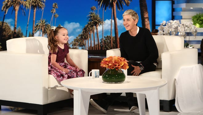 """In this photo released by Warner Bros., Brielle Milla visits with Ellen during a taping of """"The Ellen DeGeneres Show"""" at the Warner Bros. lot in Burbank, Calif."""
