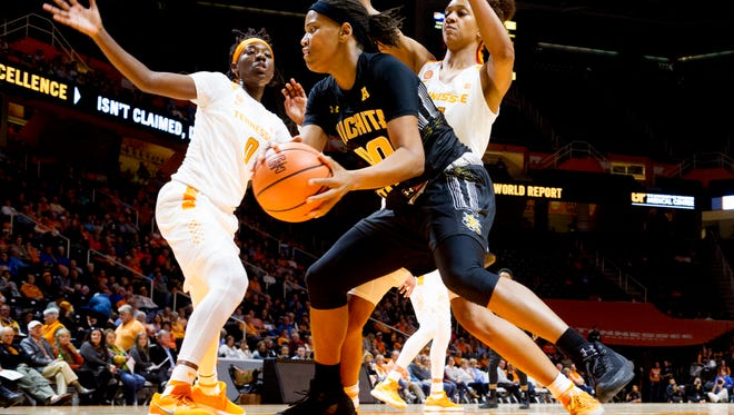 Wichita State's Angiee Tompkins (40) works past Tennessee's Jaime Nared (31) and Tennessee's Rennia Davis (0) during a game between the Tennessee Lady Vols and Wichita State at Thompson-Boling Arena in Knoxville, Tennessee on Monday, November 20, 2017.