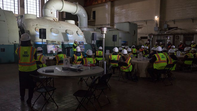 Members of the BUILD conference stop in the turbine room of the Conners Creek Power Plant for a meeting on Thursday, Nov. 16, 2017 in Detroit.