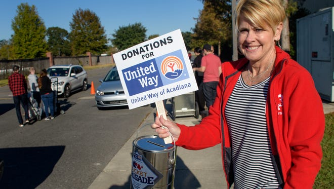 Judi Terzotis, President and Publisher of The Daily Advertiser, and President Gulf Region USA Today Network, collects donations for The United Way of Acadiana at The Daily Advertisers Thanksgiving paper presale. Wednesday, Nov. 22, 2017.