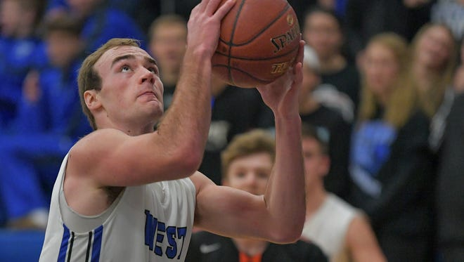 Derek Kroll (42) of Oshkosh West drives against Marshfield in a nonconference game Friday.