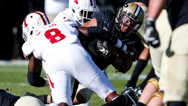 Purdue's D.J. Knox gets tackled by Tegray Scales during the 93rd playing of the Old Oaken Bucket game at Ross-Ade Stadium in West Lafayette, Ind. on Saturday, November 25, 2017.  The Boilermakers won the game, 31-24.