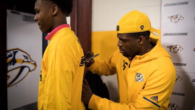 Nashville Predators defenseman P.K. Subban signs a shirt for Hunters Lane High School student Brendon King, 15, during a Blueline Buddies dinner at Bridgestone Arena in Nashville, Tenn., Tuesday, Nov. 28, 2017.