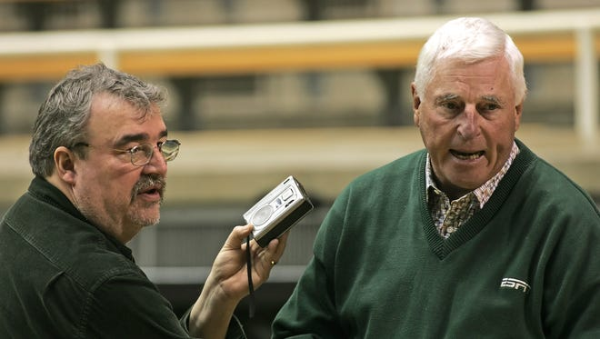 Journal & Courier sports writer Jeff Washburn interviews then-ESPN commentator and former Indiana University coach Bob Knight before the start of the Purdue-Michigan game in 2010 at Mackey Arena.