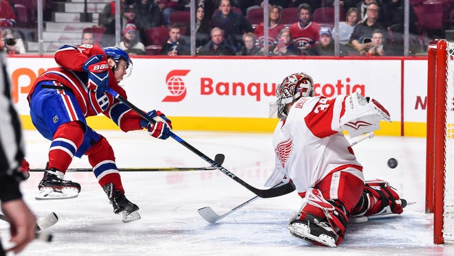 884601208.jpg MONTREAL, QC - DECEMBER 02:  Paul Byron #41 of the Montreal Canadiens scores a goal in the second period on goaltender Petr Mrazek #34 of the Detroit Red Wings during the NHL game at the Bell Centre on December 2, 2017 in Montreal, Quebec, Canada.