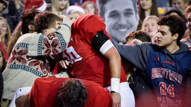 Brentwood Academy's Gavin Schoenwald (10) celebrates with fans after their Division II-AAA state championship victory against MBA at Tucker Stadium in Cookeville, Tenn., Saturday, Dec. 2, 2017.