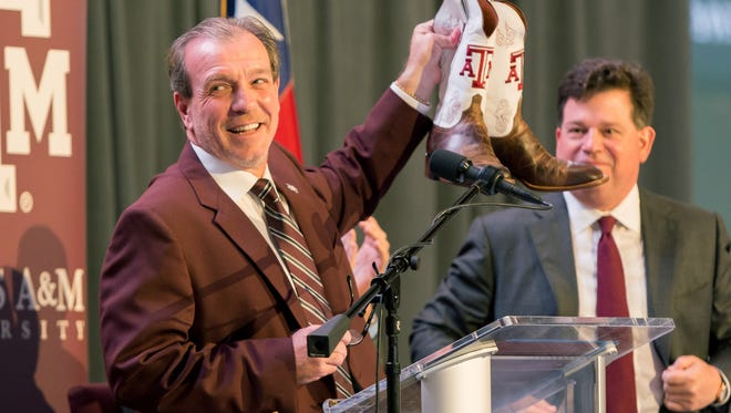 Dec 4, 2017; College Station, TX, USA; Texas A&M head coach Jimbo Fisher was gifted a pair of custom Texas A&M cowboy boots at the press conference held at the Hall of Champions in Kyle Field. Mandatory Credit: C. Morgan Engel-USA TODAY Sports