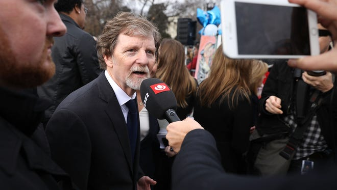 Conservative Christian baker Jack Phillips talks with journalists in front of the Supreme Court after the court heard the case Masterpiece Cakeshop v. Colorado Civil Rights Commission Dec. 5, 2017 in Washington, DC. Siting his religious beliefs, Phillips refused to sell a gay couple a wedding cake for their same-sex ceremony in 2012, beginning a legal battle over freedom of speech and religion.