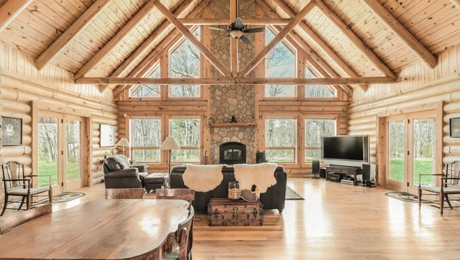The impressive fireplace and exposed chimney is the focal point of the home and an estimated 30 feet tall.