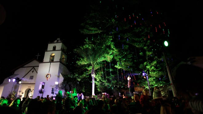 The 2015 tree-lighting ceremony takes place at the San Buenaventura Mission.
