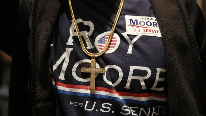 A supporter of Republican Senatorial candidate Roy Moore is seen as he attends his election night party as he runs against his Democratic opponent Doug Jones in the RSA Activity Center on December 12, 2017 in Montgomery, Alabama. Jones has been declared the winner but Moore has not conceded and may request a recount.
