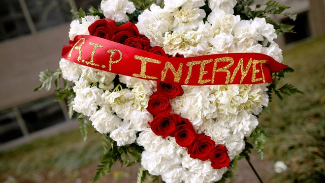 A funeral arrangement outside the FCC during a protest against the end of net neutrality rules on Dec. 14, 2017.