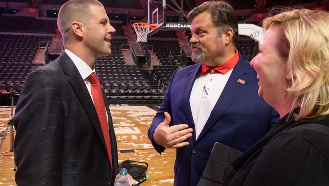 UL assistant coach Troy Wingerter, shown here talking to new UL football coach Billy Napier at his introductory press conference, has been retained as the Director of Football Operations.