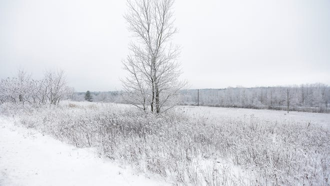 Monday snow blankets the Wausau area, Dec. 18, 2017, in Wis. T'xer Zhon Kha/USA TODAY NETWORK-Wisconsin
