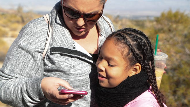 """Janeska Simmons uses the """"Agents of Discovery"""" app with her daughter, Jahliya, at the Santa Rosa and San Jacinto Mountains National Monument, December 21, 2017."""