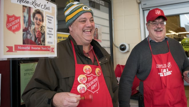 Steve and Donn Lord, sons of Helen Lord Burr, ring the bell at Pick n Save in Oshkosh on Saturday, Dec. 23, 2017. Helen Lord Burr collected donations for The Salvation Army Red Kettle drive every Christmas Eve for over 40 years. She died in September, so her family members are carrying on the tradition in the memory of all she did for the Oshkosh community.