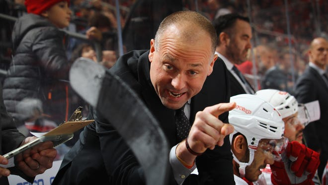 Detroit Red Wings head coach Jeff Blashill gives players direction during the third period against the New Jersey Devils at the Prudential Center on December 27, 2017 in Newark, New Jersey. The Devils defeated the Red WIngs 3-1. (Photo by Bruce Bennett/Getty Images)