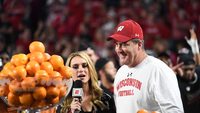 MIAMI GARDENS, FL - DECEMBER 30: Head coach Paul Chryst of the Wisconsin Badgers is interviewed following the 2017 Capital One Orange Bowl against the Miami Hurricanes at Hard Rock Stadium on December 30, 2017 in Miami Gardens, Florida. (Photo by Rob Foldy/Getty Images)