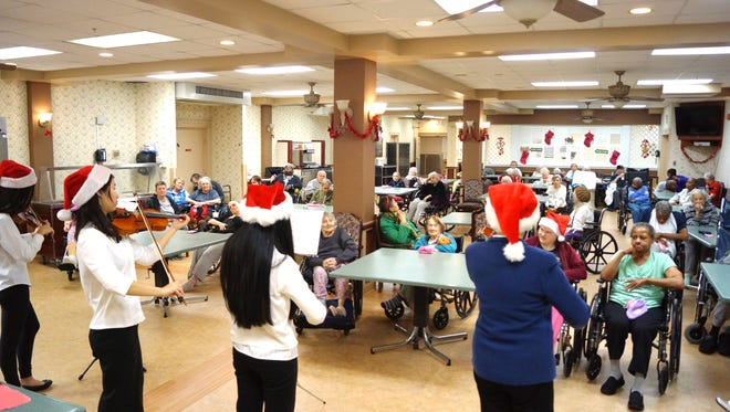 The Little Stars perform a holiday concert at Four Season Nursing Center.