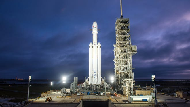 SpaceX's three-core, 27-engine Falcon Heavy launch vehicle sits on pad 39A at Kennedy Space Center in December 2017.