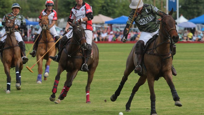 Players from Remax and Antelope Jr. compete at Empire Polo Club's opening day in Indio, Calif., January 7, 2018.