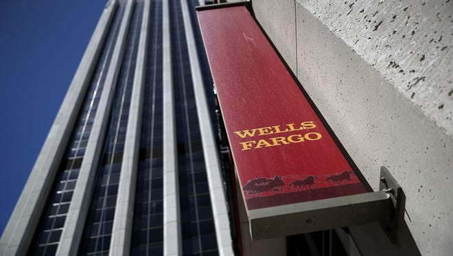 File photo taken in 2017 shows a Wells Fargo sign outside one of the bank's branches in San Francisco, California