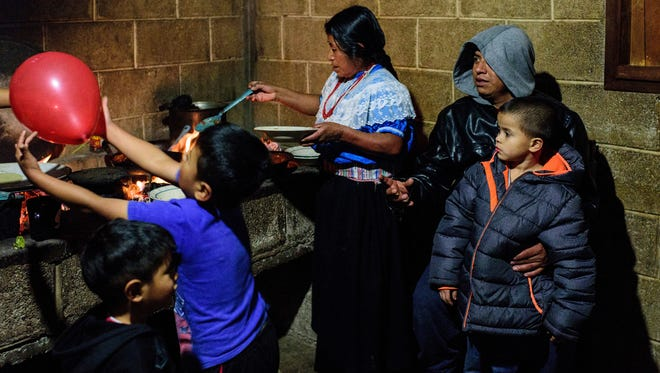 The Cuahua family prepares to eat dinner together Jan. 12, 2018, in rural Atlanca, a town in the Mexican state of Veracruz about 75 miles inland from the Gulf of Mexico.
