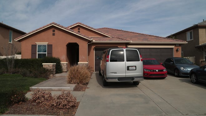 This photo shows a Perris home once occupied by the 13  Turpin siblings who endured years of abuse and torture. The Volkswagen Beetle shown to the right was stolen Feb. 14 and a Menifee man was arrested on suspicion of possessing a stolen vehicle.