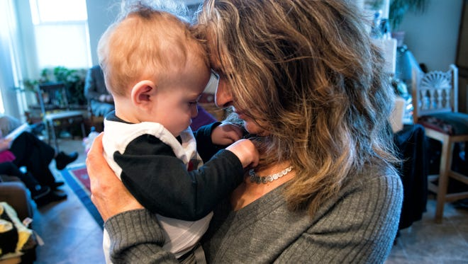 Deborah Harris, senior consultant for New Mexico's Infant Mental Health Teams, with a baby.