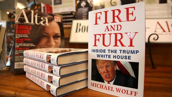 "Copies of the book ""Fire and Fury"" by author Michael"