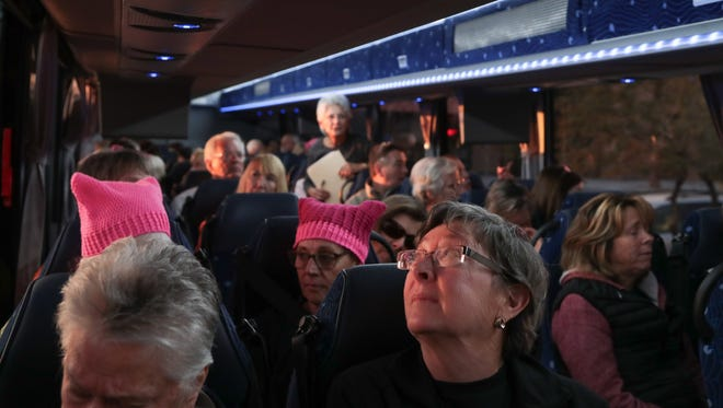 A bus of marchers leaves Palm Springs for the Women's March LA, Saturday, January 20, 2018.