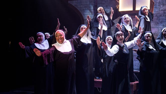 """Elizabeth Adabale, front left, as Deloris Van Cartier and company star in """"Sister Act,"""" on stage through Feb. 18 at the Simi Valley Cultural Arts Center."""
