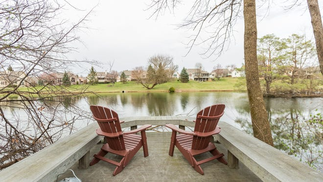 The property offers plenty of spots to enjoy the lake out back.