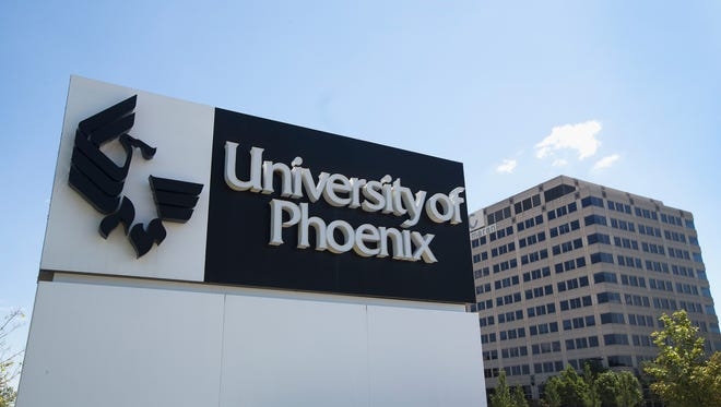 SCHAUMBURG, IL - JULY 30: A sign marks the location of the University of Phoenix Chicago Campus on July 30, 2015 in Schaumburg, Illinois. The university, the nation's largest recipient of veteran educational funds, is under federal investigation for possible deceptive or unfair business practices. (Photo by Scott Olson/Getty Images) ORG XMIT: 567761799 ORIG FILE ID: 482409796