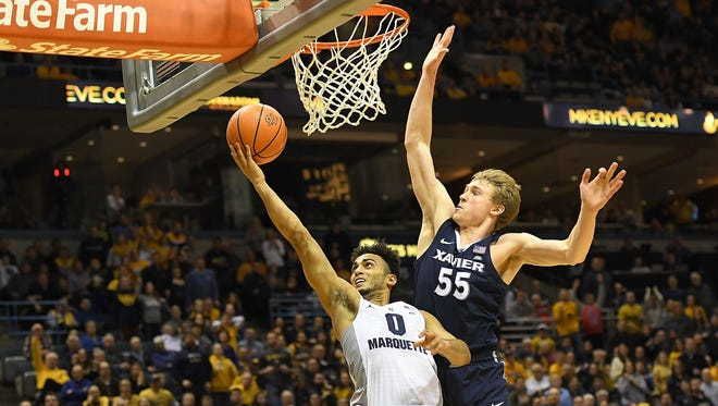 Marquette's Markus Howard tries to make a layup against Xavier's J.P. Macura in December.