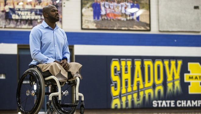 John Flowers poses for a portrait on Thursday, Jan. 18, 2018 at Shadow Mountain High School in Phoenix. Flowers, an assistant coach for the Shadow Mountain basketball team, lost both legs in a car accident in 1992 when he was beginning his college basketball career.