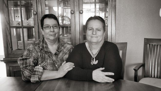 Glenda Chavez and Linda Griego share a quite moment together in Albuquerque.