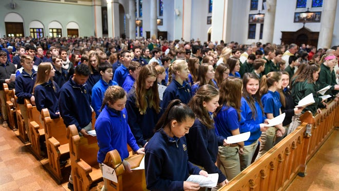 Students from all 26 diocesan Catholic schools attend a Mass celebrating National Schools at Evansville's Saint Benedict Cathedral Tuesday, January 30, 2018.
