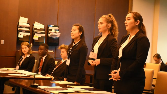 In the final round, Team Kagan attorneys Madison Hopkins, left, Leah Pearce and Cami Hennel introduce themselves.