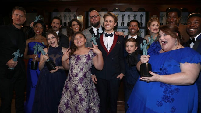 """The cast of """"This Is Us"""" poses backstage at the 24th annual Screen Actors Guild Awards at the Shrine Auditorium & Expo Hall on Sunday, Jan. 21, 2018, in Los Angeles. (Photo by Matt Sayles/Invision/AP)"""