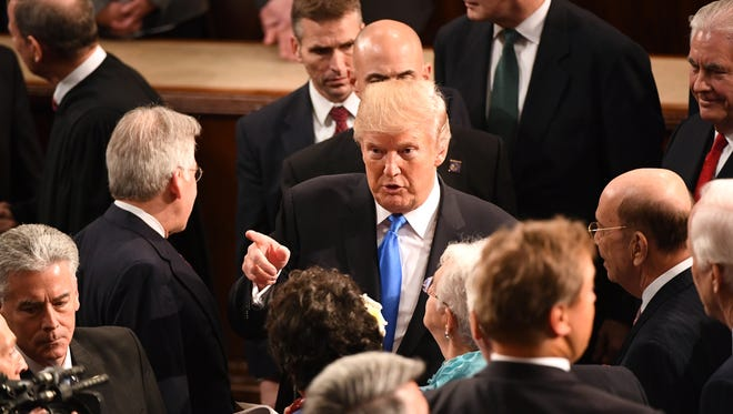 President Trump shakes hands with members of congress after delivering the State of the Union address on Tuesday, Jan. 30, 2018.