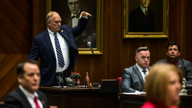 Rep. Don Shooter drops his microphone after giving a statement during a vote on whether to remove him from office on Feb. 1, 2018, at the Arizona House of Representatives chambers in Phoenix.