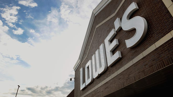 File photo taken in 2017 shows the Lowe's sign at one of the home improvement retailer's stores in Chicago.