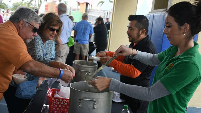 Elizabeth Soto of Mango's pours chicken corn chowder. The Marco Island Area Chamber of Commerce held its sixth annual Souper Bowl on Saturday, raising money for scholarships while giving attendees the chance to sample soups from area eateries.